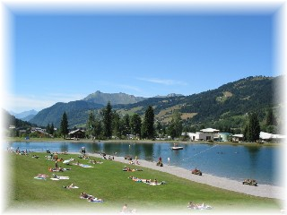Stroll across the piste to the beautiful supervised bathing lake